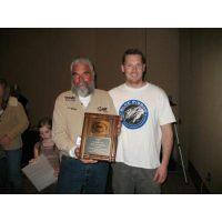 Griz displays his National Fishing Hall of Fame plaque
