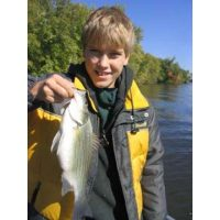 Another kid holding a tough fighting white bass