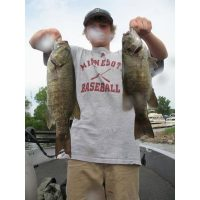 Beautiful smallies caught by the youngster on a surface plug