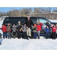 The entire boy scout troop enjoying a day on the ice with Josh!