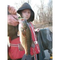 Godson Jeremy Knutson with a bass caught in Febuary in open water