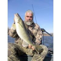 Good friend of Josh, the Griz, with one of many big walleyes he has got out of the river