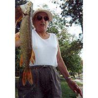 Grandma Stevenson with pike she caught on a spoonplug