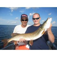 Jerry and Mel Novak display a nice pike they caught while trolling at 7mph with Josh