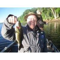 Josh\'s Father-in-Law, Steve Kinzel, holds his smallmouth bass he caught in the spring of 2010