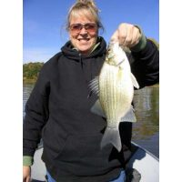 Mom with a big white bass. Cindy went on to catch 8 more on one spot