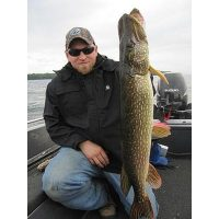 Phil Meers shows off his beautiful mid-day Mille Lacs Pike. He caught it on a dreamcatcher