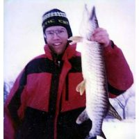 Tom Knutson with a nice Tiger he caught through the ice