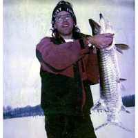 Tom with one of many tiger muskies he caught through the ice with Josh