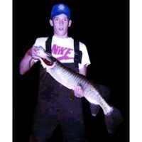 14 year-old Josh with a nice Tiger caught while night fishing for muskies